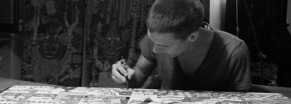 Léonard Combier sur sa table à dessin
